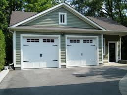9x8 haas 660 carriage doors in white with 6 pane windows