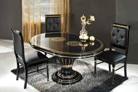 antique dining tables and black leather chairs with black wool rugs under oval table