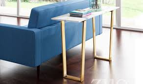 zuo atlas modern console table in stone gold lifestyle view