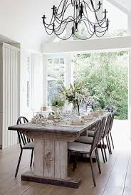 light fixture for high ceiling the long arm chandeliers add an airy feeling to a breathtakingly airy room with a large window a d high ceilings