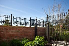 wrought iron fence brick. Fence Design Continues Onto A Brick Wall Wrought Iron N