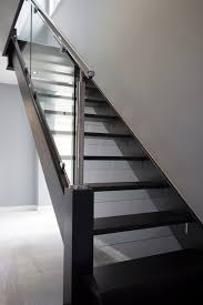 polished steel staircase with black oak tread and glass risers