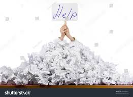 person under crumpled pile papers hand stock photo  person under crumpled pile of papers hand holding a help sign isolated against a white