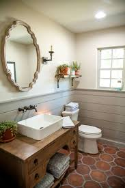 Gray shiplap wainscoting added dimension to this powder room without  overwhelming the small space.