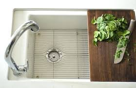 kohler sink with cutting board kitchen with sliding cutting board sink sink accented with off set