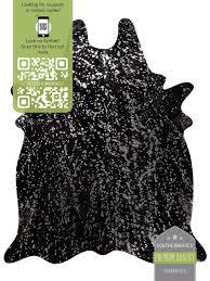 silver on black cowhide rug