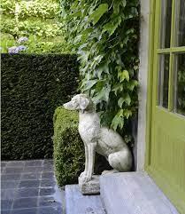 sos hunting dog garden statues