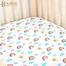 pastel rainbow crib sheet