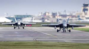 two royal canadian air force cf 18 hornets in action at calgary airport