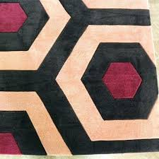 orange and white swirl area rug s black h
