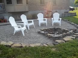 chic patio furniture with pea gravel patio and firepit also boulder landscape borders