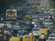 traffic congestion   in a massive increase in the number of private vehicles on its roads overwhelming the transport infrastructure shown here is a traffic jam in delhi