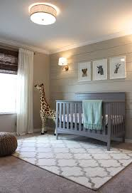 beige and gray boy nursery with beige shiplap accent wall