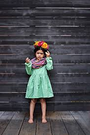 to create you own frida kahlo headband you will need the following faux flowers reds pinks yellow orange color with some leafy green stems