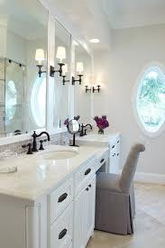 circa lighting bathroom traditional with black fixtures beige mosaic tile backsplash