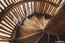 old retro wooden spiral staircase in the ancient bell tower of the orthodox church in russia