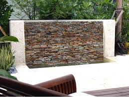 mesmeric natural stone wall with water fountain for best exterior house