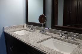 wooden framed mirrors and white sinks using grey granite countertop for small bathroom decor
