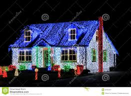 Christmas Lights Show Display on House at Night Royalty Free Stock