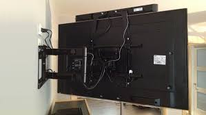 installing a tv wall bracket to hang a