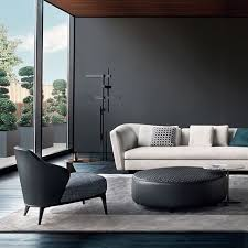 minotti lighting. minotti furniture seymour sofa leslie armchair yang pouf and joy side table lighting