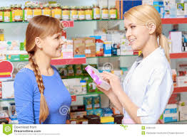 Pharmacist Consultant Pharmacist And A Customer Choosing Medicine Stock Image Image Of