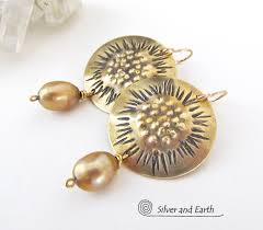 gold br earrings with sculptural texture gold pearls unique handmade artisan jewelry