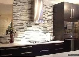 white countertop espresso kitchen cabinet gray glass mosaic backsplash tile tile backsplash kitchen subway