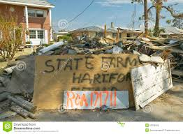 state farm insurance agency sign and debris in front of house heavily hit by hurricane ivan in pensacola florida