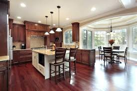 cherry cabinet kitchens cherry wood flooring and natural toned wood cabinetry warm up this kitchen featuring