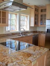 elegant kitchen photo in portland maine with glass front cabinets stainless steel appliances and
