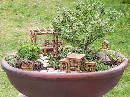 fairy garden pots. Sure To Attract Garden Fairies And Pixies Your Yard, This Miniature Fairy Ivy Furniture Set Is A Fun Whimsical Addition Flowerbeds Pots N