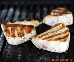tuna steaks cooking on grill