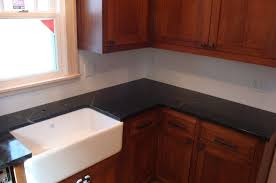 great black soapstone countertop for kitchen with hardwood kitchen cabinet