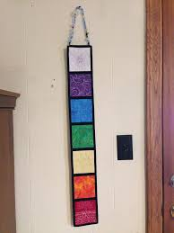 How to Hang a Quilt: 3 Creative Ways & hanging-chakra-wall-hanging Adamdwight.com