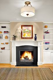 built in bookshelves fireplace family room traditional with wood trim traditional fireplace crown molding