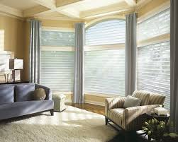 Add drapery to your bay window treatments for a custom look.