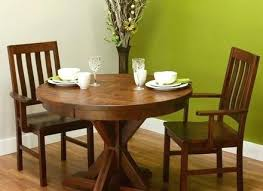 amish oak dining table with self storing leaves round chairs set solid wood pedestal rustic plank amish dining table and chairs round
