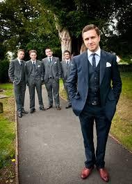 I love the idea of the <b>groom</b> in navy and the <b>groomsmen</b> in <b>dark</b> grey
