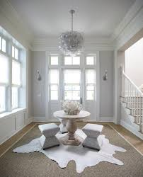 White And Gray Beach Cottage Foyer With Center Table Oly Studio Clever Muriel  Chandelier Briliant 4