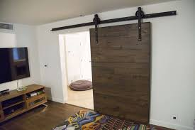 interior wonderful dark brown wood textured sliding barn door decor interior with white painted wall and brown floor also brown wood tv stand cabinet what