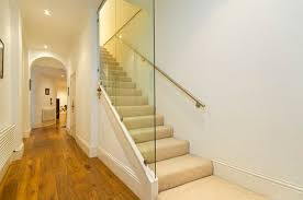 View in gallery Choose glass walls for tight staircase ...