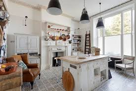 View in gallery Beautiful shabby chic style kitchen with tiled flooring  [From: Bruce Hemming Photography]