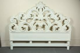 glamorous carved wood baroque headboard it is finished in glossy white