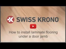 how to install laminate flooring under a door jamb