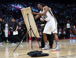 houston tx february 16 jeremy evans of the utah jazz signs a painting