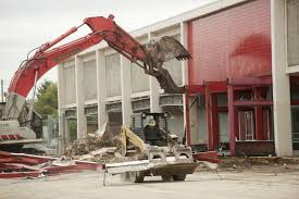 crews from staton co work to demolish the old fred meyer at grand and fourth plain boulevards to make way for a proposed grocery that has yet