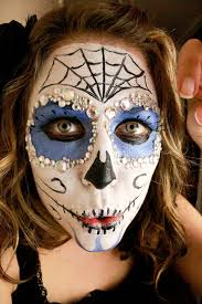 face painted like a sugar skull from el dia de los muertos day of the dead ryan used her as the inspiration for what you see below