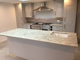 image of colonial white granite countertops natural maple cabinets