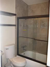 bathroom tub shower combo with sliding glass door by black floating over toilet shelf doors
